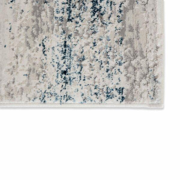 """Astra """"Antea"""" Teppich im Design 201 in der Farbe Creme-Blau, Nahansicht der Ecke."""