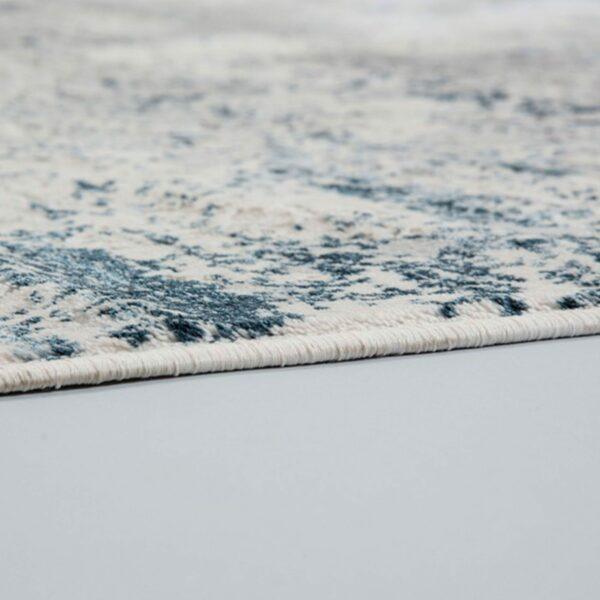 """Astra """"Antea"""" Teppich im Design 201 in der Farbe Creme-Blau, Nahansicht der Kante."""