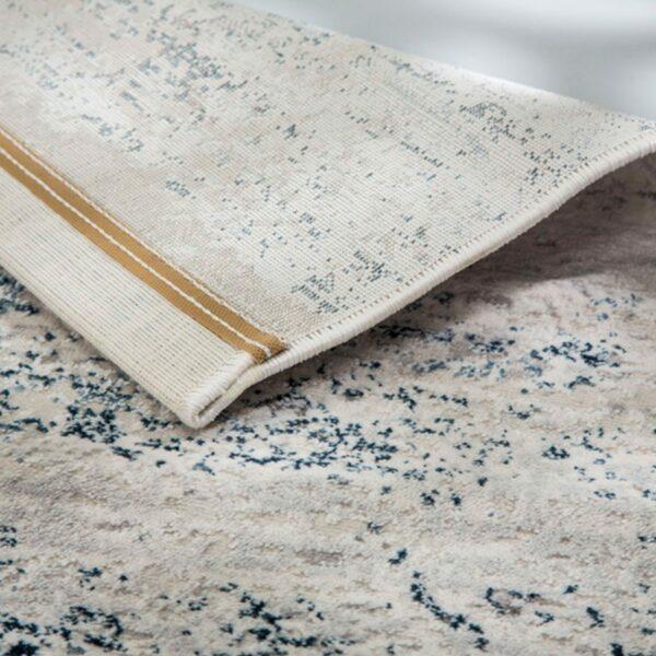 """Astra """"Antea"""" Teppich im Design 201 in der Farbe Creme-Blau in Rückansicht."""
