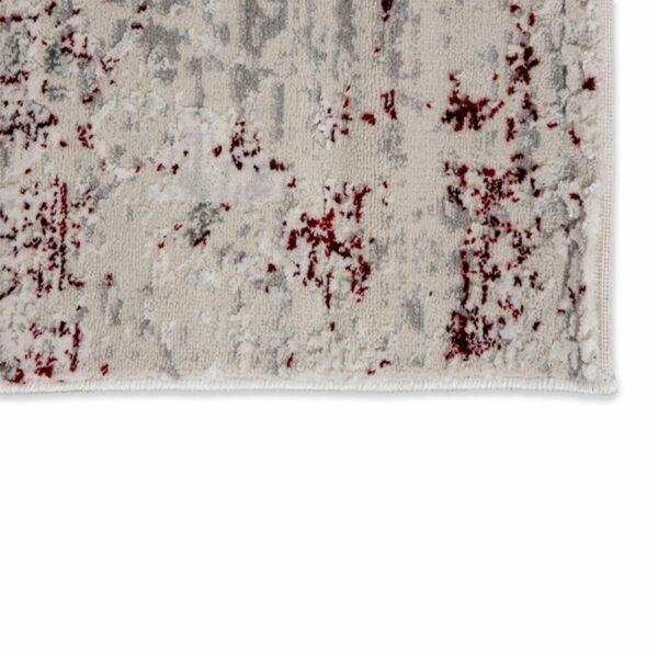 """Astra """"Antea"""" Teppich im Design 201 in der Farbe Creme-Rot, Nahansicht der Ecke."""