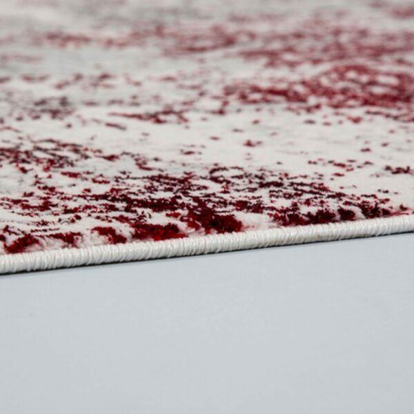 """Astra """"Antea"""" Teppich im Design 201 in der Farbe Creme-Rot, Nahansicht der Kante."""