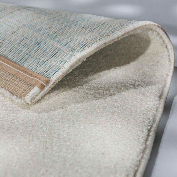 """Astra """"Pure"""" Teppich in der Farbe Creme zeigt Ansicht der Rückseite."""
