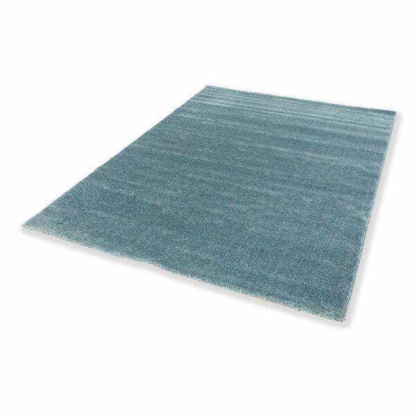"""Astra """"Pure"""" Teppich in der Farbe Türkis in liegender Ansicht."""