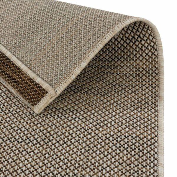 """Astra """"Rho"""" Teppich im Design 190 mit der Farbe Braun, Nahansicht der Rückseite."""