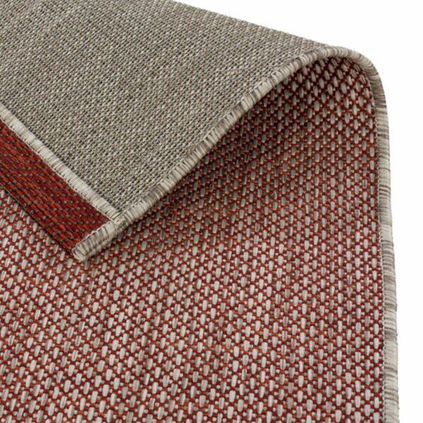 """Astra """"Rho"""" Teppich im Design 190 mit der Farbe Rot, Nahansicht der Rückseite."""