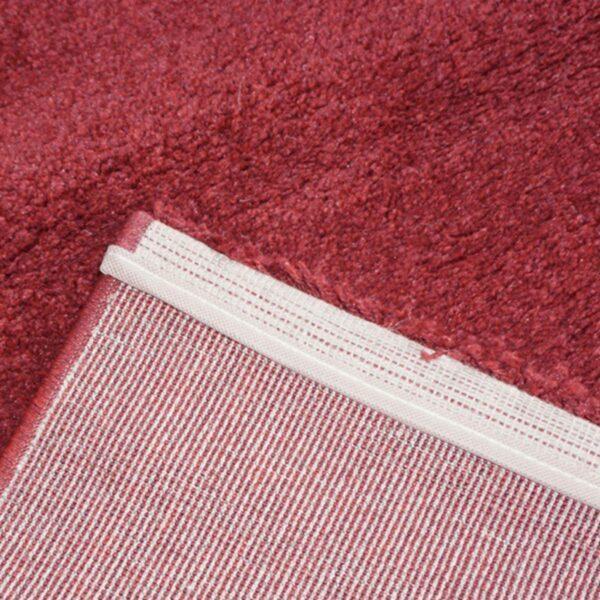 """Astra """"Samoa"""" Teppich in der Farbe Rot in Detailansicht."""