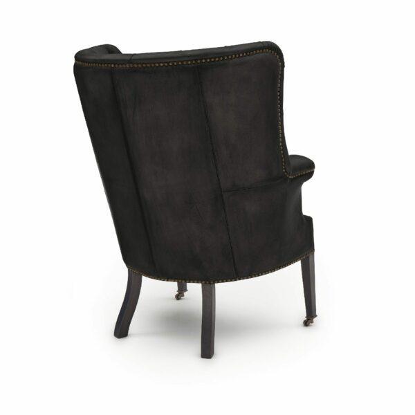 """WK Wohnen """"5001"""" Armlehnensessel mit Lederbezug Buffalo in der Farbe Black matt in Rückansicht."""