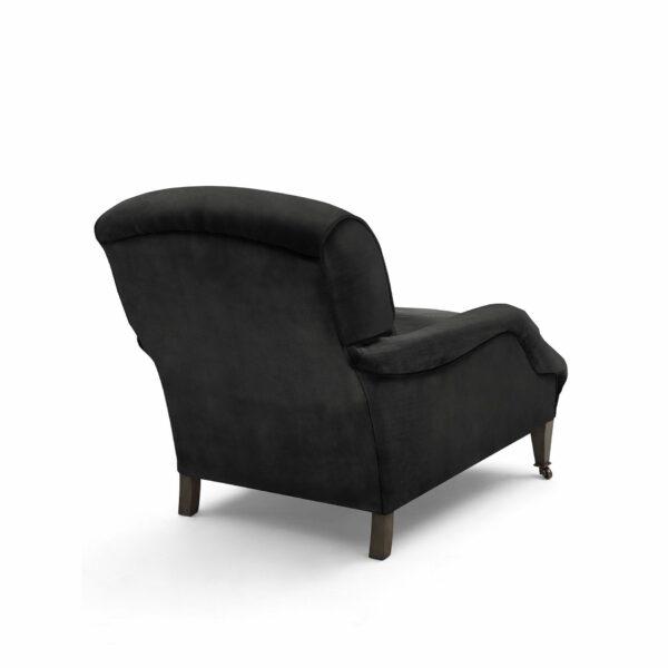 "WK Wohnen ""5006"" Longchairsessel mit Lederbezug Buffalo in der Farbe Black matt in Rückansicht."