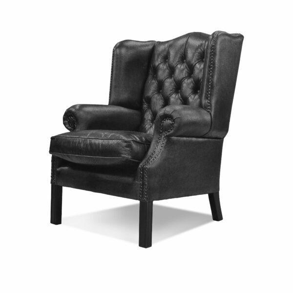 """WK Wohnen """"5005"""" Armlehnensessel mit Lederbezug Buffalo in der Farbe Black glänzend in seitlicher Ansicht."""