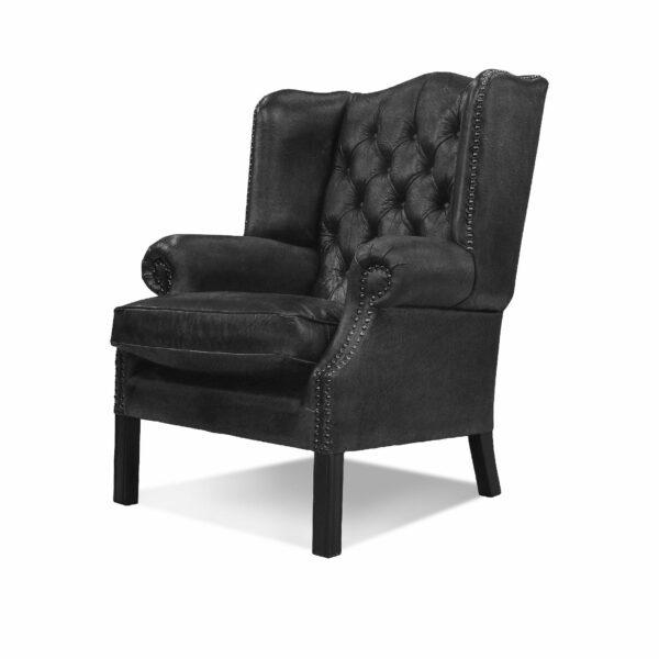 """WK Wohnen """"5005"""" Armlehnensessel mit Lederbezug Buffalo in der Farbe Black matt in seitlicher Ansicht."""