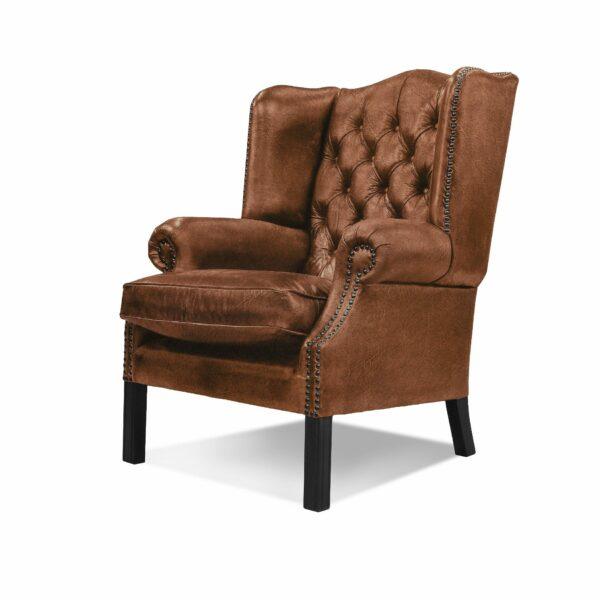 """WK Wohnen """"5005"""" Armlehnensessel mit Lederbezug Buffalo in der Farbe Light Brown matt in seitlicher Ansicht."""