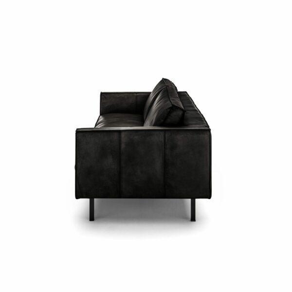 WK Wohnen Edition 6001 Sofa mit Bezug Leder Buffalo glänzend in der Farbe Black von der Seite.