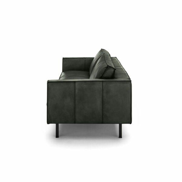WK Wohnen Edition 6001 Sofa mit Bezug Leder Buffalo glänzend in der Farbe British Green von der Seite.