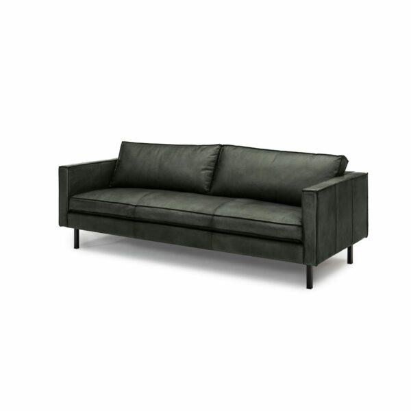 WK Wohnen Edition 6001 Sofa mit Bezug Leder Buffalo glänzend in der Farbe British Green in seitlicher Ansicht.