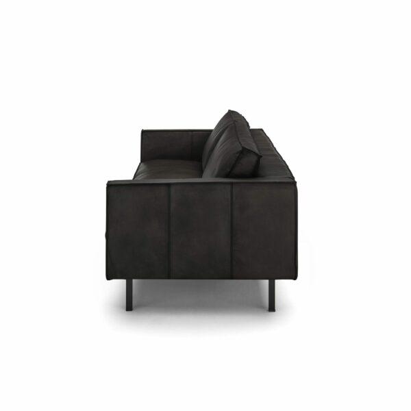 WK Wohnen Edition 6001 Sofa mit Bezug Leder Buffalo matt in der Farbe Black von der Seite.