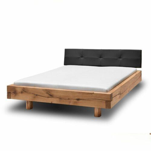 Natura Baltimore Bett aus massiver Wildeiche mit gepolstertem Kopfteil als Freisteller.