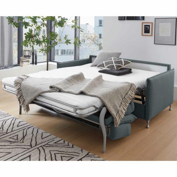 Das Sofa MR 855 lässt sich im Handumdrehen zum Bett verwandeln